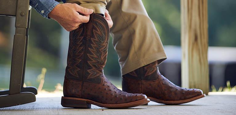 Man sliding on boots